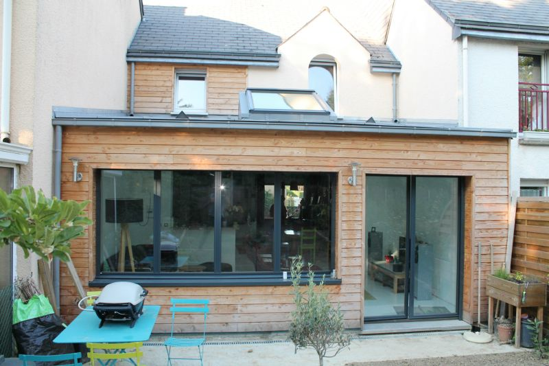 Extension maison bois construction services for Agrandissement verriere